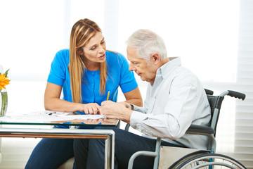 Consultation of senior man in wheelchair