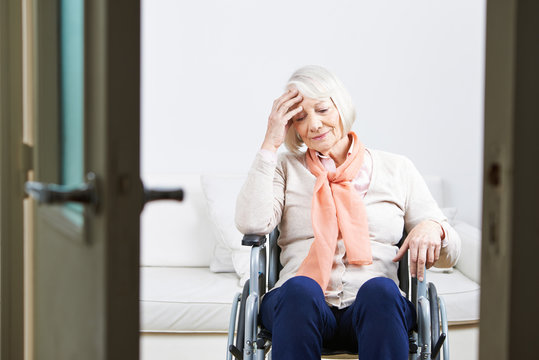 Old lonely woman in wheelchair