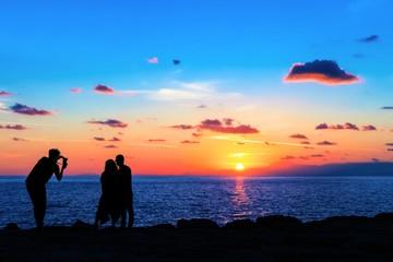 Traumhafter Sonnenuntergang mit Fotograf