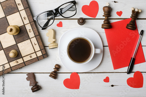 A Cup Of Coffee Glasses And Chess Pieces On A Wooden