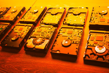 hard disk drives in a rows, warm orange tone