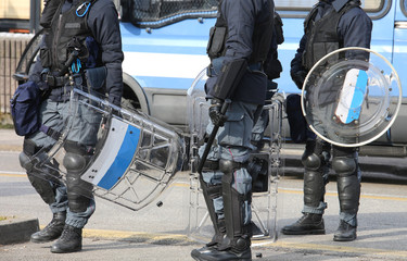 police with shields and helmets during the uprising town