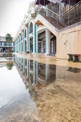 vivid building with mirror shadow