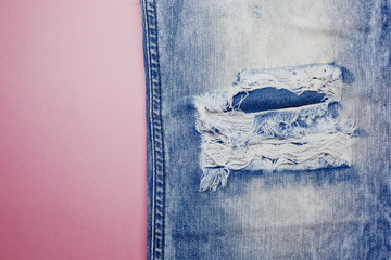 Jeans texture on pink background