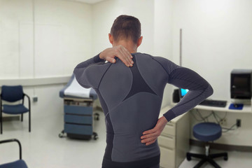 Chiropractic, osteopathy, Physiotherapy, sport injury rehabilitation. Alternative medicine, pain relief concept. Man patient suffering from back pain during medical exam.