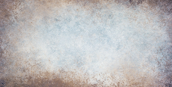 old stained blue and white background with dirty grunge textured borders and elegant rustic vintage style design with light center and dark grungy border