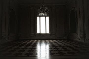 Window lit with mysterious white light in a spooky room built in