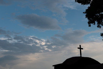 silhouette of the cross on a cloudy sky
