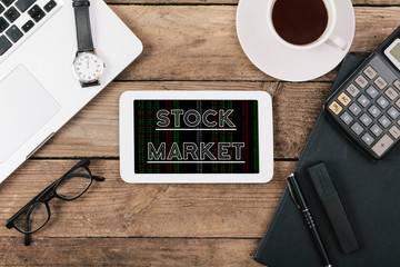 Stock Market text on tablet computer, Office desk with computer
