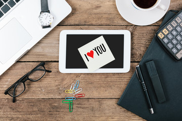 I Love You text on tablet computer, Office desk with computer te