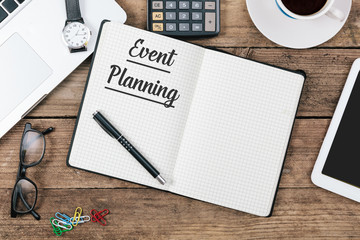 Event Planning text on note pad, Office desk with computer techn