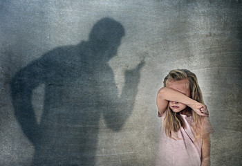 father or teacher shadow screaming angry reproving young sweet little schoolgirl or daughter