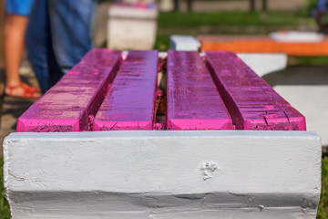 Freshly painted bench closeup
