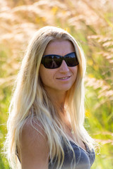 Attractive blonde  woman with blurred background