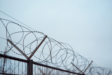 Fence with barbed wire. focus with shallow depth of field.