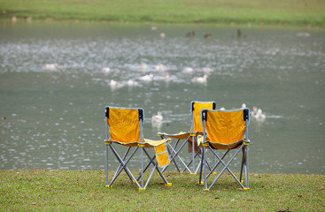 Chairs on lake side