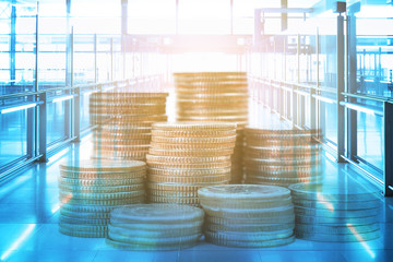 Coins stack over building interior with retro color effected use