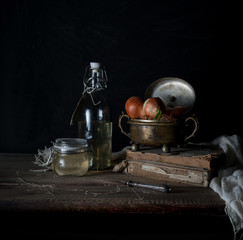 Still life with onions on a wooden table on a dark background
