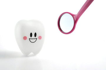smiling teeth toy emotion with dental mirror pink isolated on white background, with clipping path