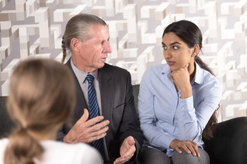 Diverse Partners Discussing Issue with Lawyer