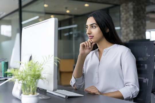 Confident young businesswoman working in office