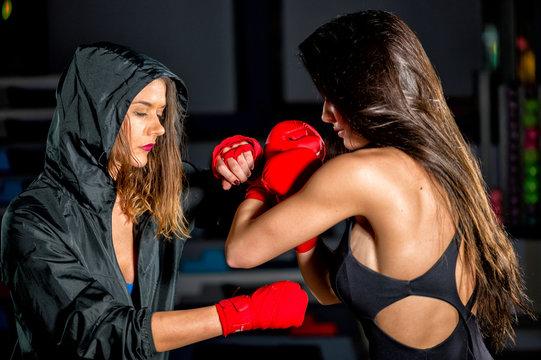 Two beautiful girls before kick box match