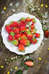 Organic strawberry, strawberries in white rustic plate