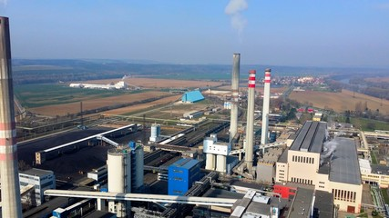Air view on the factory with some smokestack. Picture of destroying atmosphere and our world.