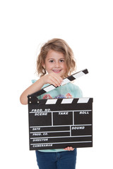 Young girl with clapperboard