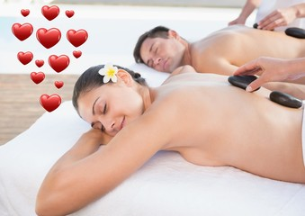 Couple getting spa treatment