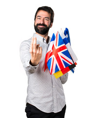 Handsome man with beard holding many flags and coming gesture