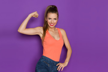 Young Beautiful Woman Flexing Biceps