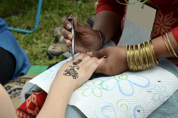 realization of henna tattoo on hand
