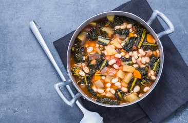 Vegetables soup with legumes top view.Traditional tuscany soup, ribollita.