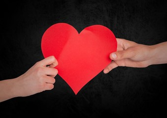 Couple with heart and black background