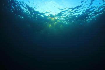 Underwater sunburst and ocean background photo