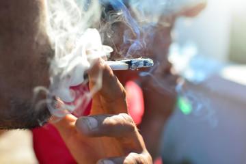 Man smoking cigarette . focus on cigarette.