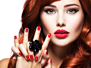 Beautiful sensual woman with  red nails. Fashion makeup.