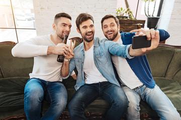Happy male friends taking a selfie