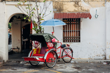 Rickshaw tricycle at the street of the George Town, Malaysia
