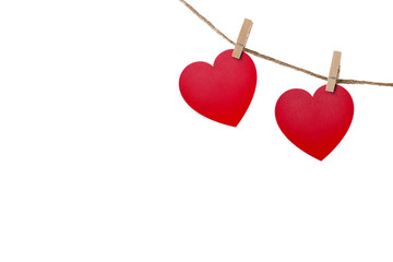 Love hearts hanging on rope on white with clipping path