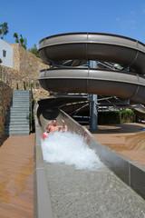 boy having fun on a water slide