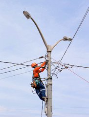 Electrician at work in pole