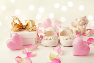 baby shoes, flowers and gift box
