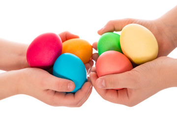 many easter eggs in two child hands