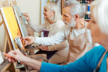 Three professional artists spending time in painting studio