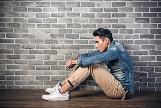 man sit on ground feel lonely
