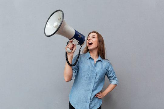 Woman screaming in megaphone