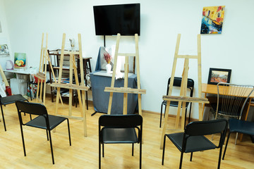 Painting studio with easels standing in it