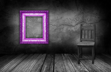 purple frame and wood chair in interior room with gray stone wal